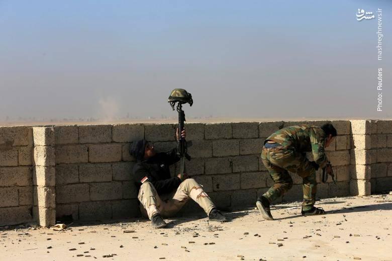 تلاش سرباز عراقی برای تحریک نیروهای داعش- رویترز