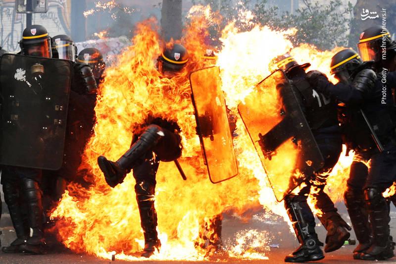 آتش گرفتن پلیس فرانسوی طی تظاهرات کارگران به مناسبت روز جهانی کارگر