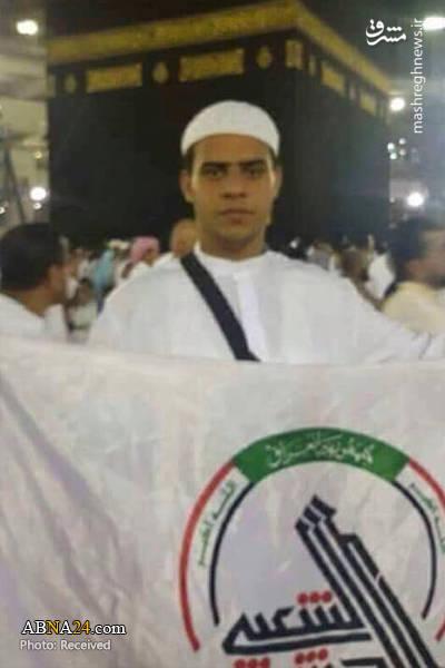 اهتزاز پرچم الحشد الشعبی در جوار خانه خدا