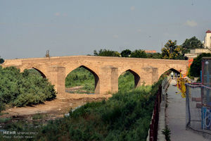 عکس/ بازسازی پل 800 ساله آققلا در شمال کشور
