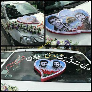 عکس/ تمثال شهدا روی ماشین عروس