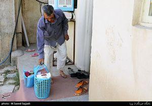 عکس/ توزیع بسته های غذایی در مناطق محروم تهران
