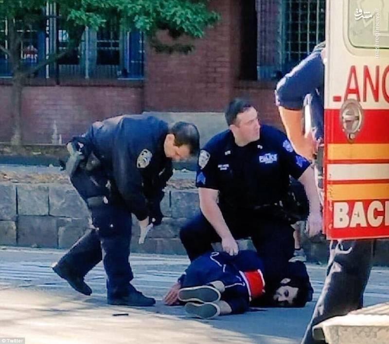 عامل تیراندازی منطقه منهتن بعد از بازداشت توسط نیروهای پلیس