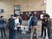 پخش شربت و شیرینی به مناسبت پیروزی جبهه مقاومت توسط دانشجویان بسیجی دانشگاه تهران.