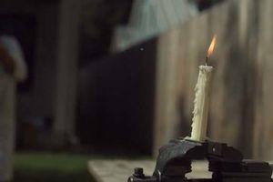 تصویر آهسته شلیک گلوله به شعله شمع