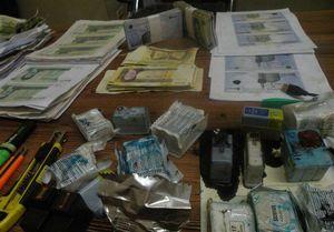 عکس/ کشف اسکناسهای جعلی در کرمانشاه
