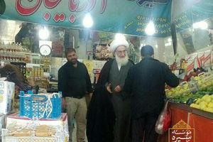 عکس/ آیتالله نوریهمدانی در حال خرید میوه