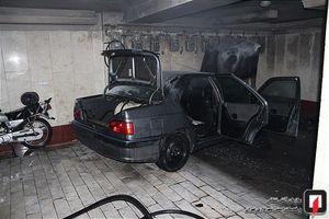 عکس/ آتش سوزی خودرو در پارکینگ ساختمان