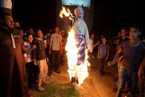 عکس/ساکنان نوار غزه ترامپ را به آتش کشیدند