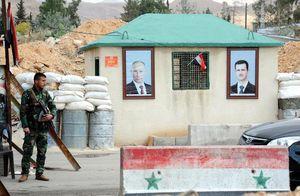 تصویر بشار اسد و پوتین در ایست بازرسی سوریه