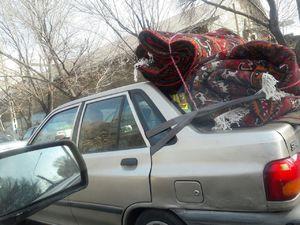 عکس/ استفاده از کمربند صندلیهای عقب برای حمل بار!