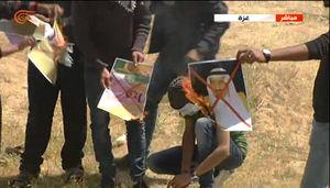 فیلم/ آتش زدن عکس سران آل سعود در غزه