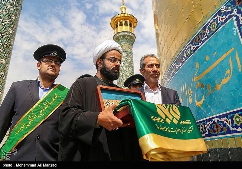 رونمایی و اهتزاز پرچم جدید حرم حضرت معصومه (س)
