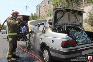 آتش گرفتن پژو 405 در اکباتان+عکس