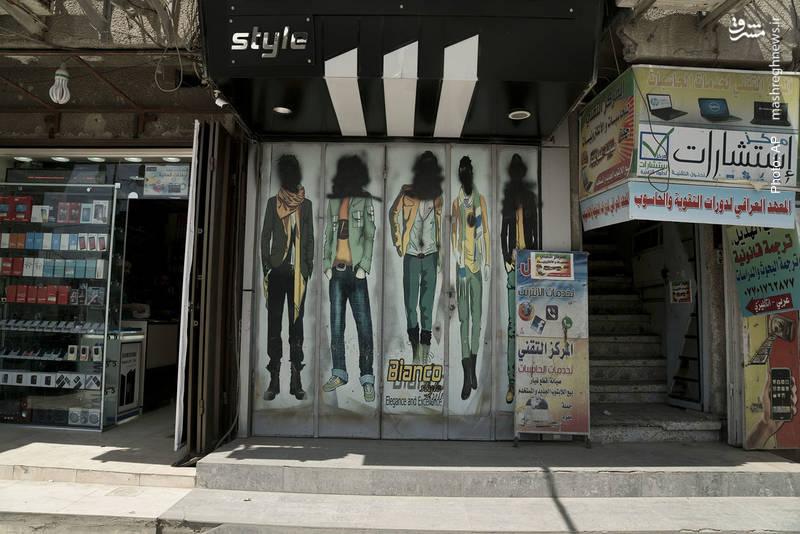 سیاهکردن چهره در بنرهای تبلیغاتی موصل در دوره اشغال این شهر از سوی داعش