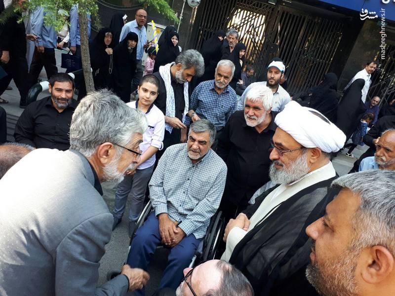 غلامعلی حدادعادل و حجت الاسلام رحیمیان در میان جانبازان دفاع مقدس در راهپیمایی روز قدس