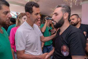 عکس/ دیدار بشار اسد و همسرش با جانبازان
