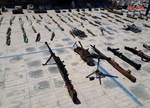 عکس/ کشف تسلیحات به جامانده از تروریستها در حمص