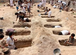 عکس/ خاکسپاری کودکان شهید یمنی