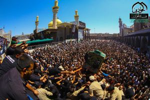 عکس/ تشییع نمادین پیکر امام جواد(ع) در کاظمین
