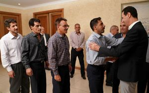 عکس/ دیدار بشار اسد با کارگران سوری