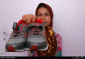 عکس/ اهدای لوازمالتحریر به کودکان حاشیهنشین تهران