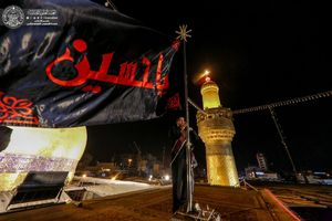 تعویض پرچم ایوان طلای حرم علوی