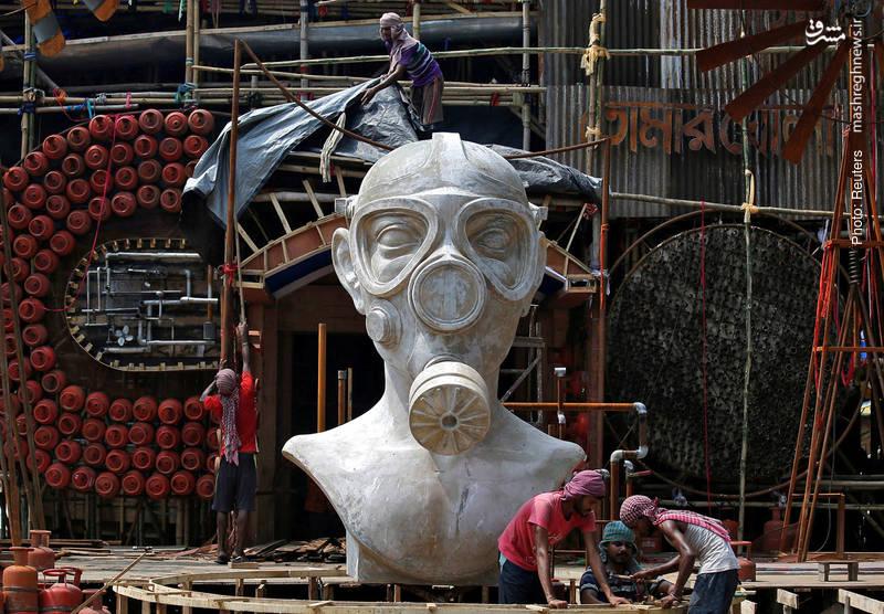 طراحی مجسمهای در کلکلته هند با هدف آگاهیبخشی نسبت به مضرات آلودگی هوا که با توجه به استفاده از آن در جشنوارههای مذهبیِ پیشِرو می توان آن را «خدای آلودگی هوا» نامید.