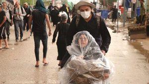 عکس/ پیادهروی اربعین در باران