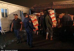 عکس/ همکاری ارتش عراق بعد از طوفان با مواکب ایرانی