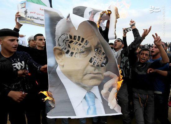 عکس/ آتش زدن عکس نتانیاهو در نوار غزه