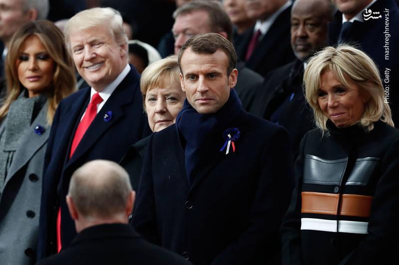 واکنش متفاوت سران سه کشور به حضور پوتین در پاریس. همسر پیر رئیس جمهور جوان فرانسه در کنار همسر جوان رئیس جمهور پیر آمریکا در حاشیه گردهم آیی صدمین سال پایان جنگ جهانی اول