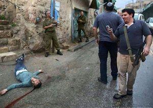 شادی صهیونیستها از کشتن یک نوجوان! +عکس