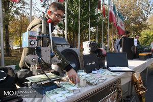 عکس/ کشف دستگاه جعل اسکناس در تهران
