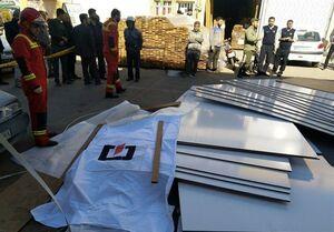 مرگ کارگر جوان زیر پالتهای چوبی +تصاویر