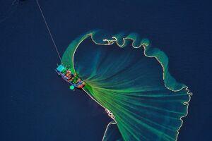 تصویری زیبا از ماهیگیران ویتنامی