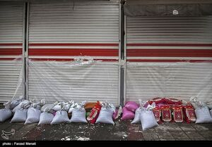 عکس/ پیشگیری مردم کرمانشاه در مواجهه با سیل