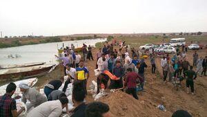 عکس/ مجاهدت هزاران نفره برای ساخت سیلبند