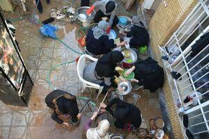 عکس/ کمکرسانی بانوان بسیجی در سیل شیراز