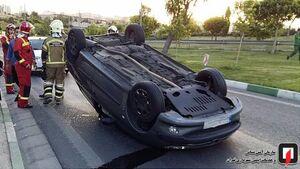 عکس/ واژگونی خودرو سواری در بزرگراه باکری