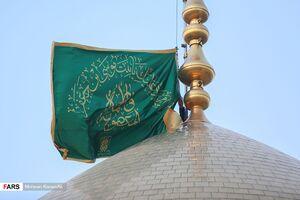 عکس/ آئین تعویض پرچم حرم حضرت معصومه(س)