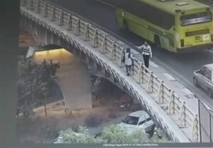 نجات یک دختر جوان از خودکشی از روی پل+ تصاویر
