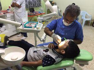 کمک پزشکان جهادی به کودکان جنگ زده +عکس