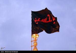 عکس/  آیین تعویض پرچم گنبد حرم حضرت معصومه (س) - قم