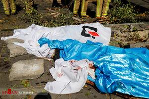 عکس/ اجساد قربانیان سقوط جرثقیل در تهران