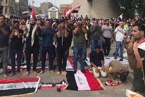 توزیع آب و غذا میان معترضان توسط وزارت کشور عراق