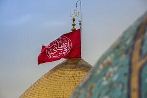 عکس/ تعویض پرچم حرمین شریفین در کربلا