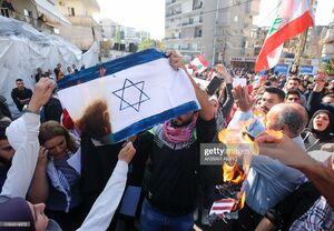عکس/ آتش زدن پرچم اسرائیل و آمریکا در لبنان