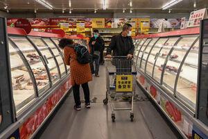 عکس/ هجوم مردم چین به فروشگاهها