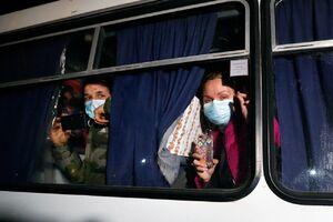 عکس/ بازگشت پرحاشیه از ووهان چین